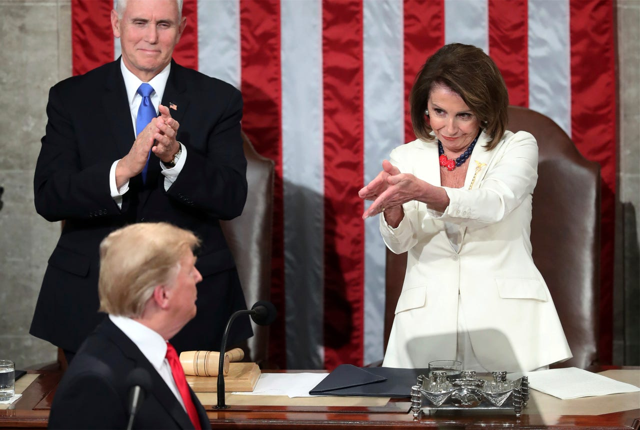 2019-02-05: President Donald Trump turns to House Speaker Nancy Pelosi of Calif., as he delivers his State of the Union address to a joint session of Congress on Capitol Hill in Washington, as Vice President Mike Pence watches, on Feb. 5, 2019.