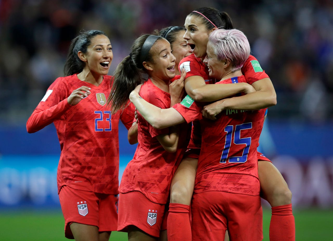 2019-06-11: United States' Alex Morgan, second right, celebrates after scoring her side's 12th goal during the Women's World Cup Group F soccer match between United States and Thailand at the Stade Auguste-Delaune in Reims, France, Tuesday, June 11, 2019. Morgan scored five goals during the match