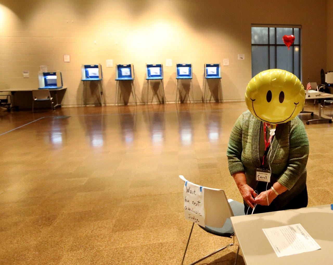 2019-11-05: Election judge Carol Johnson ties a balloon to a chair before the polls open, Nov. 5, 2019, at the Arlington Hills Community Center in St. Paul, Minn.
