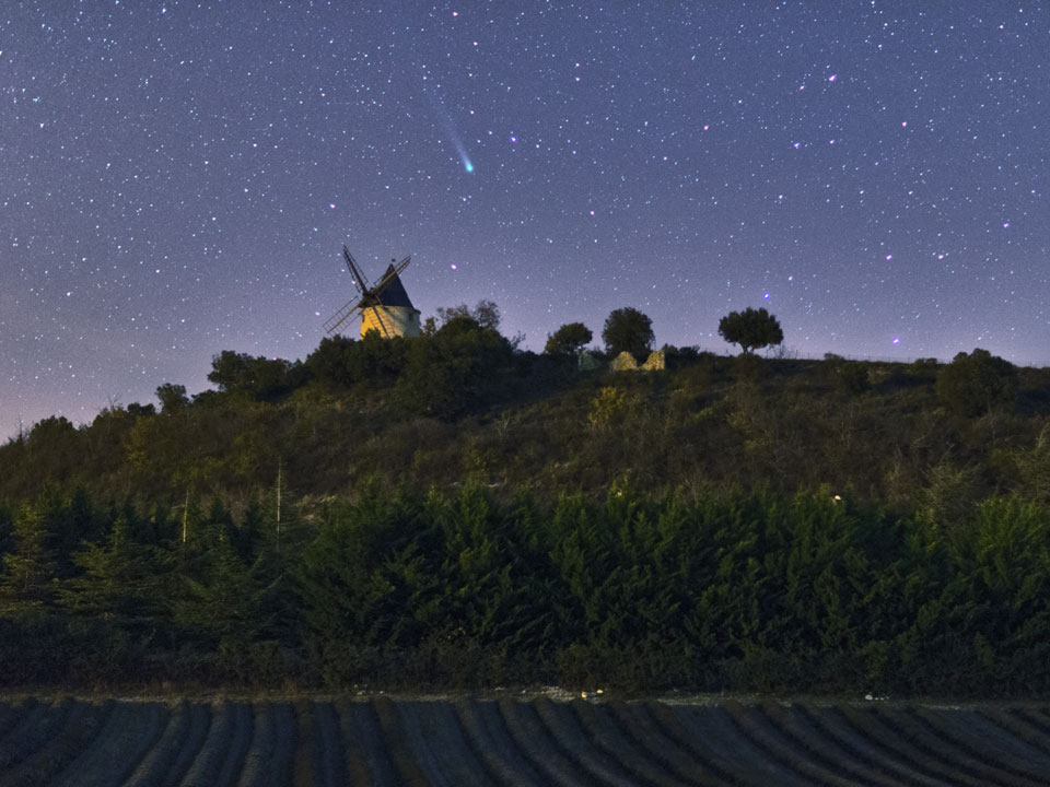 Comet Lovejoy posing over a windmill